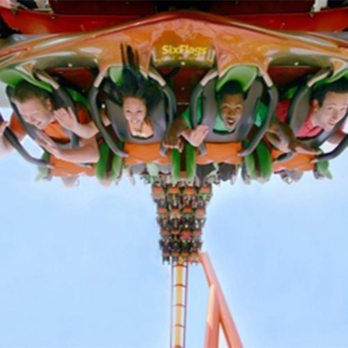 People on the Tatsu ride at Six Flags Magic Mountain hanging upside down