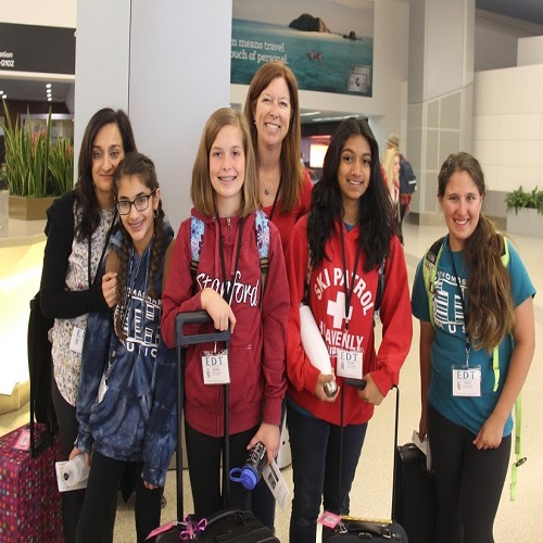 students checking in at the airport
