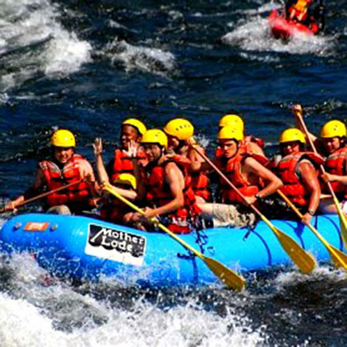 Group of students white water rafting on the American River during a school trip